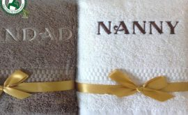 Khăn bông thêu logo Nanny
